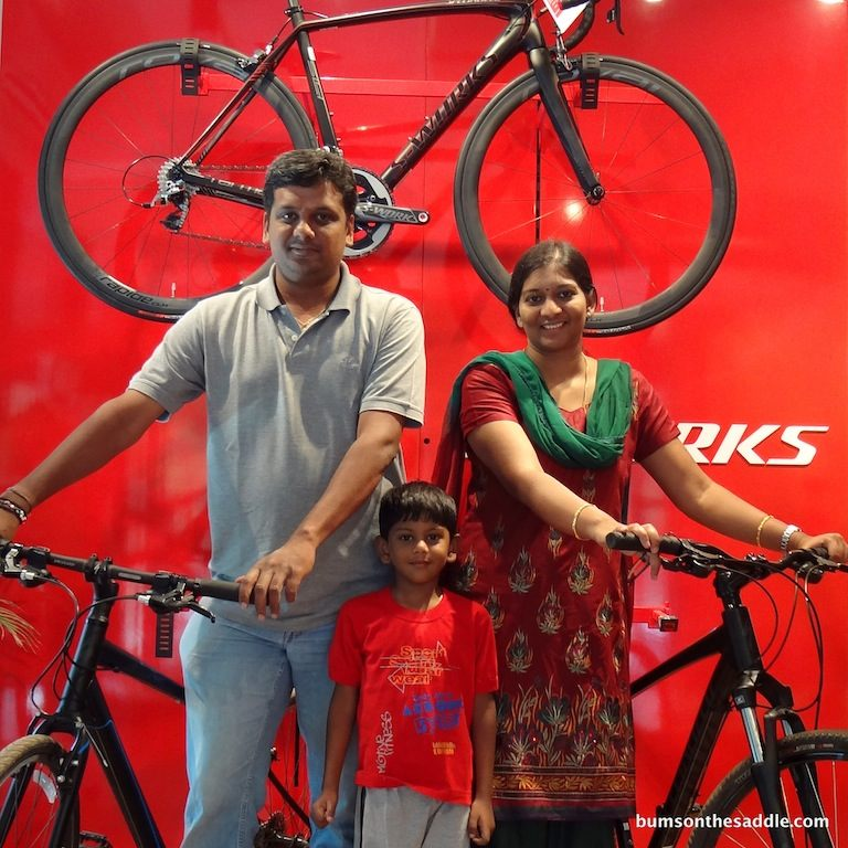Commuters in Bangalore - in front of the Specialized Sworks wall