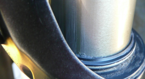 A scratched stanchion due to lack of lubrication and care.